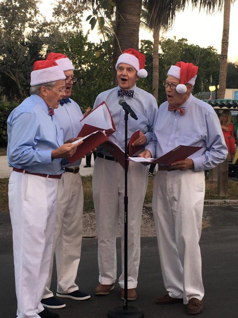 men with santa hats singing